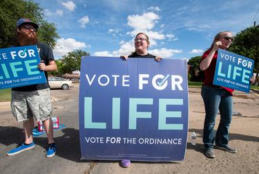 Josh Upchurch, Shelby Martin and Hailee Roberts campaign for Proposition A at the corner of Quaker Ave. and 82nd Street on Saturday, May 1, 2021, in Lubbock, Texas.