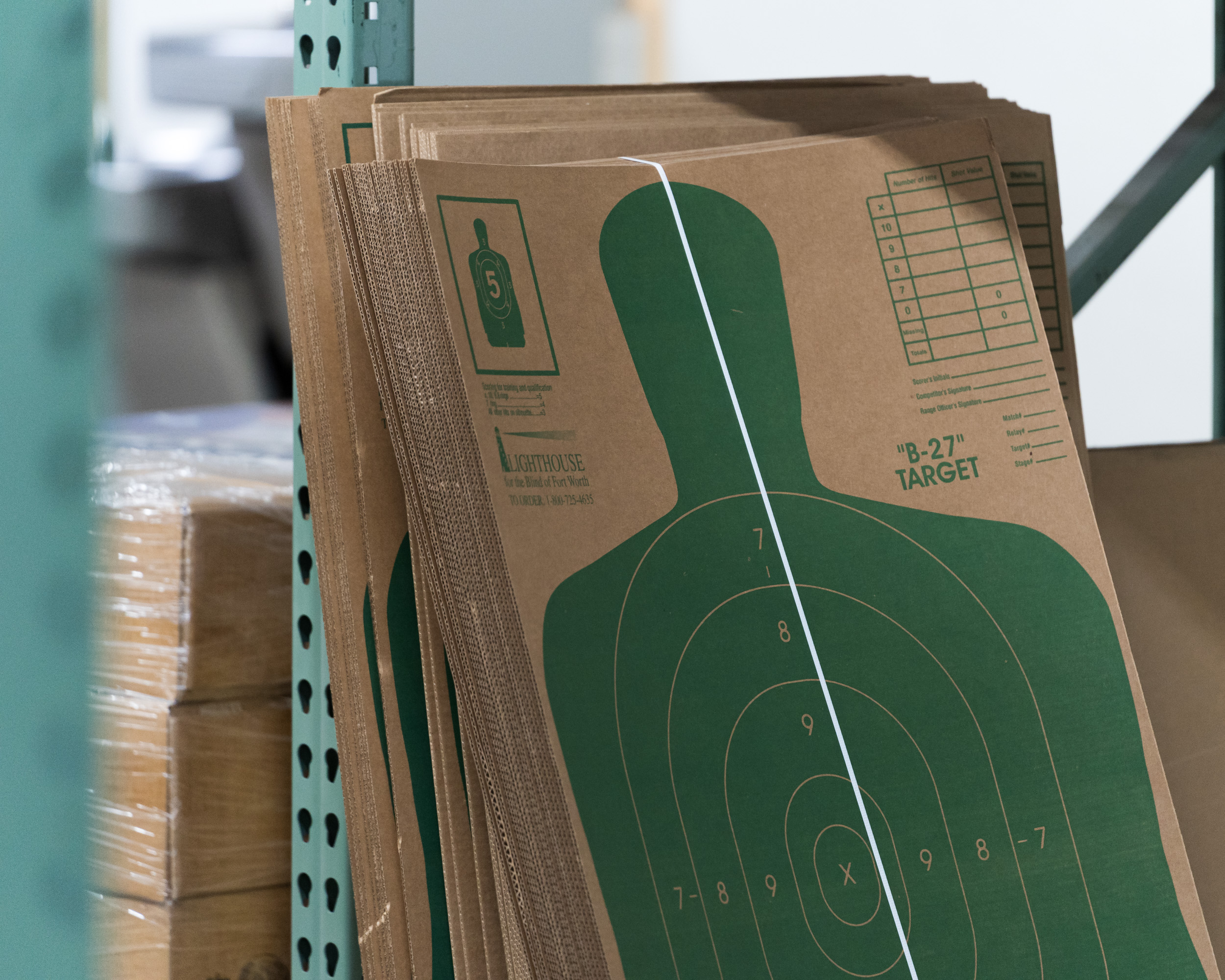 A cardboard with a figure of a man used for target practice