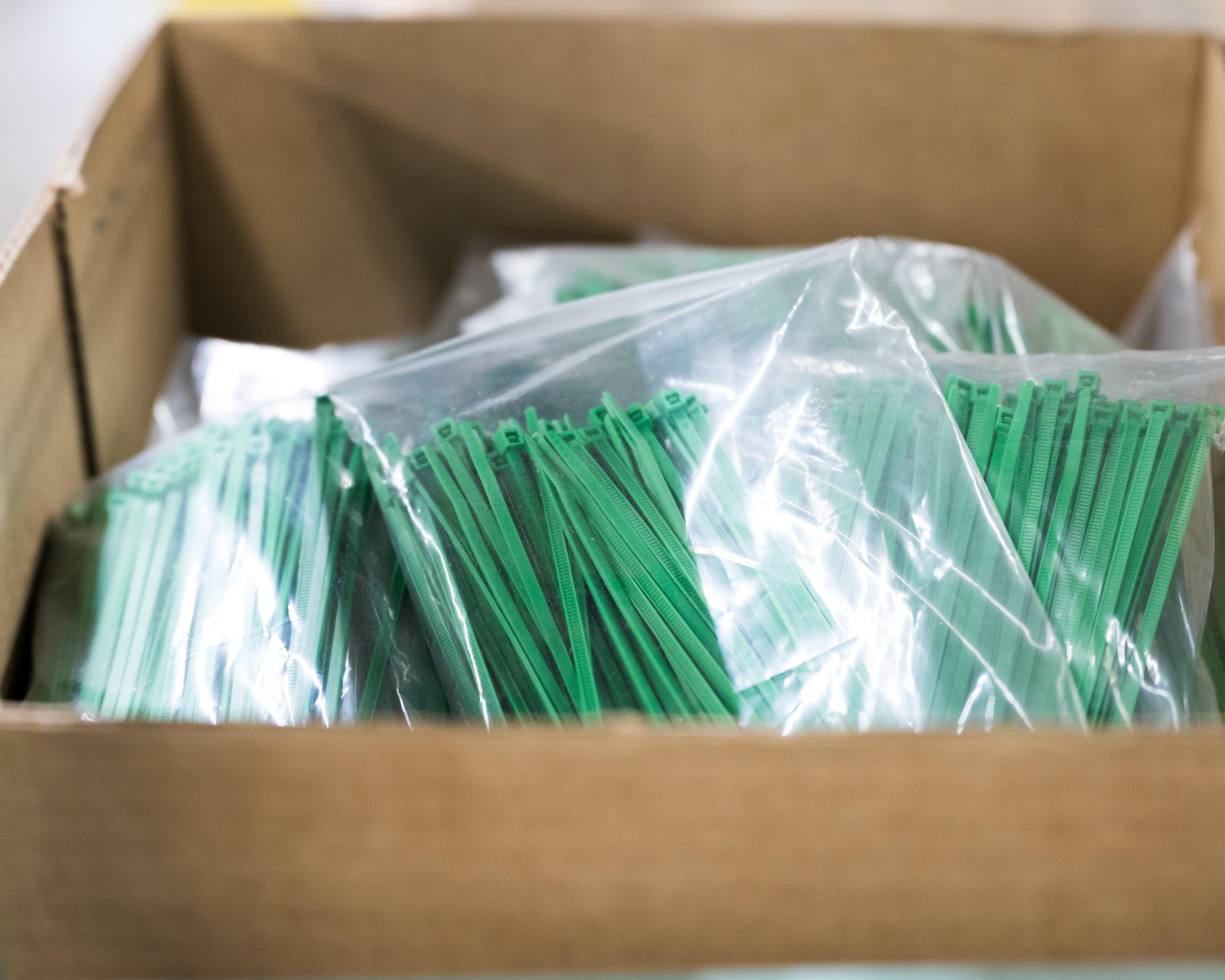 A box of green zip-ties