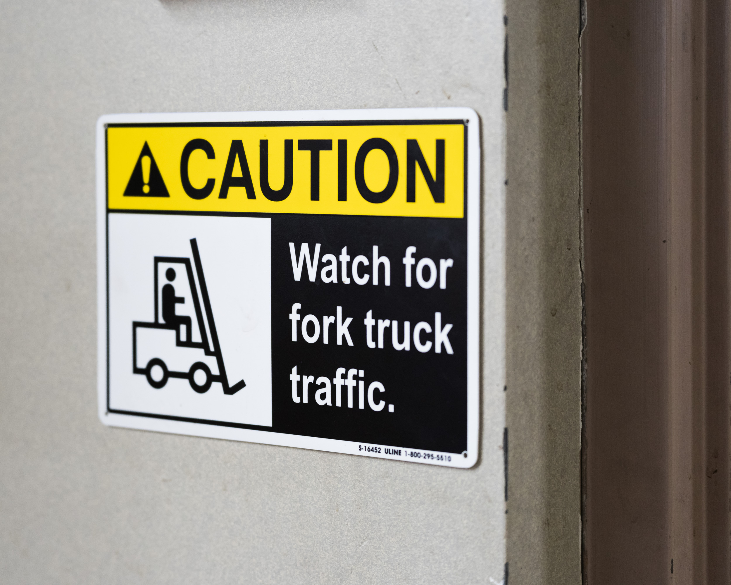 """Sign that says: """"Caution: Watch for fork truck traffic."""""""