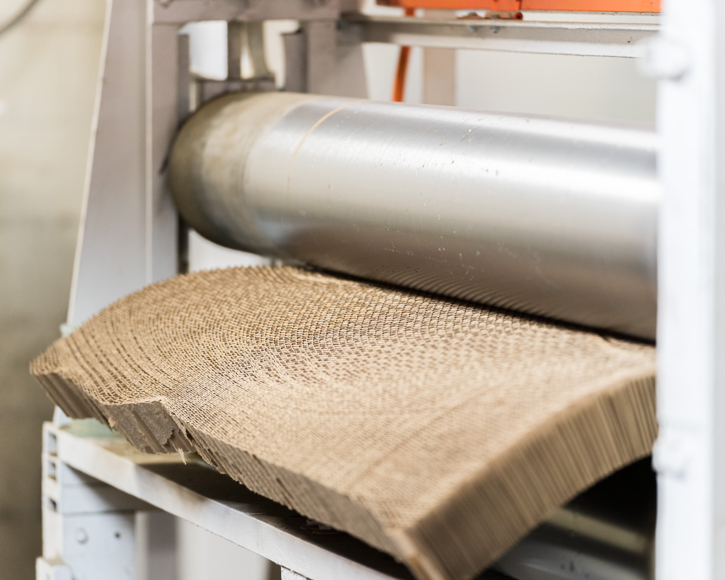 Brown padding paper coming out of a machine