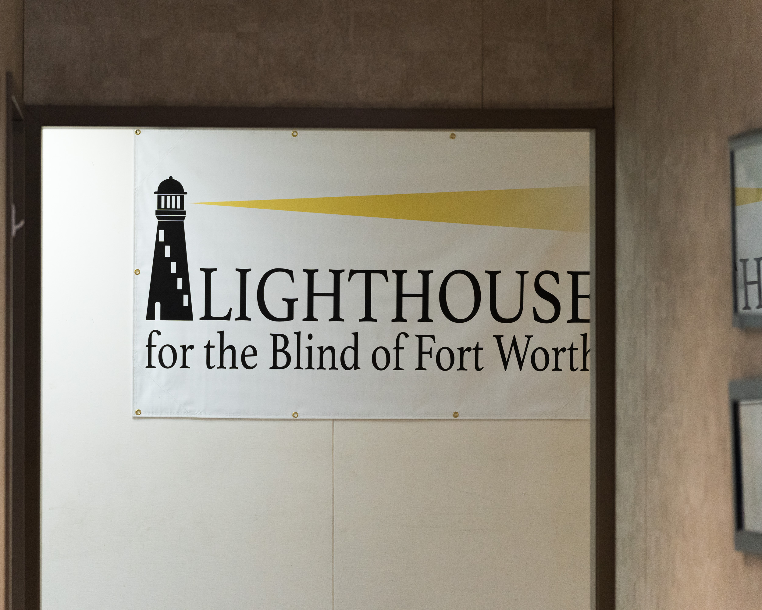 """A poster that says, """"Lighthouse for the Blind of Fort Worth"""""""