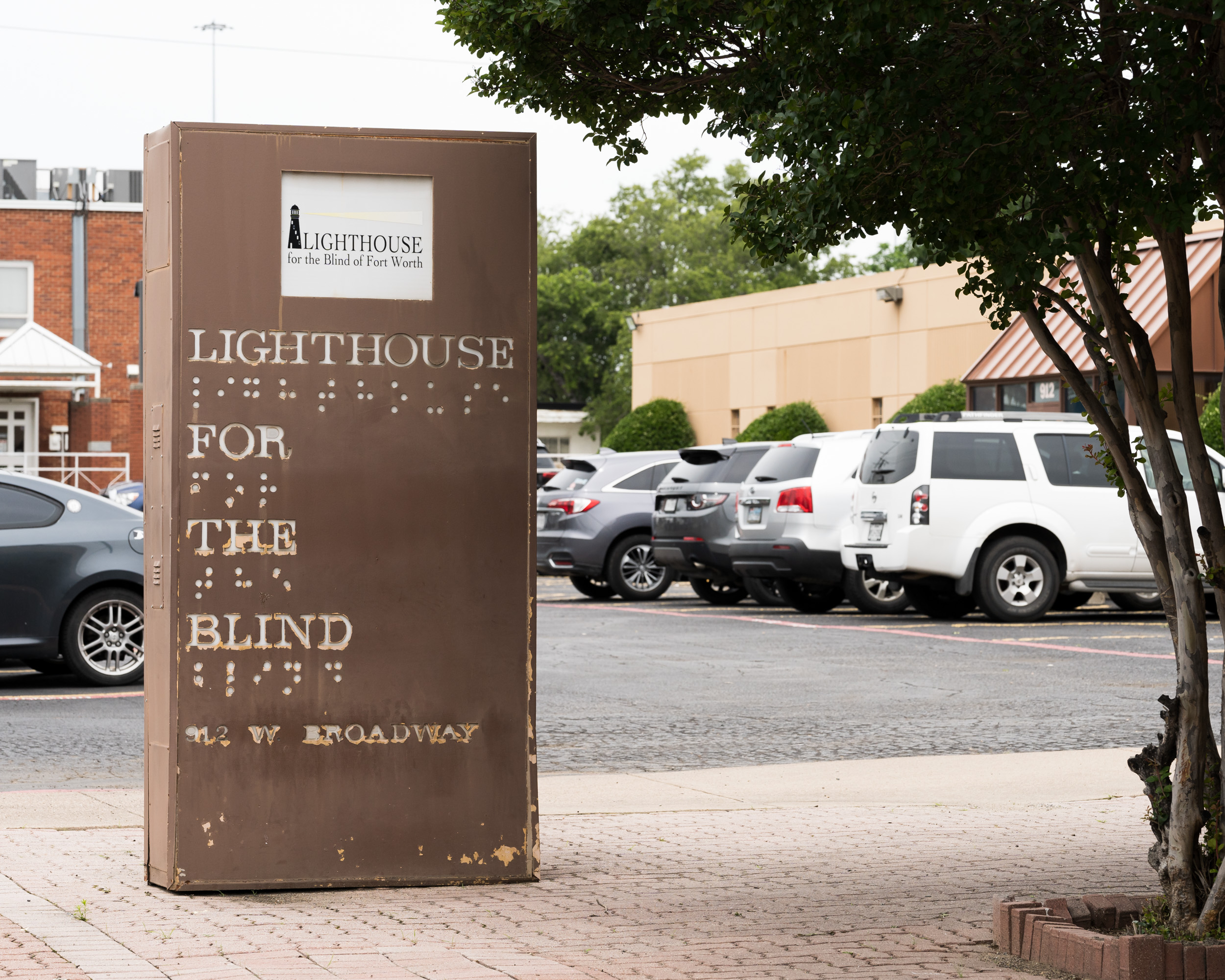 """An outdoor sign that says, """"Lighthouse for the Blind"""""""