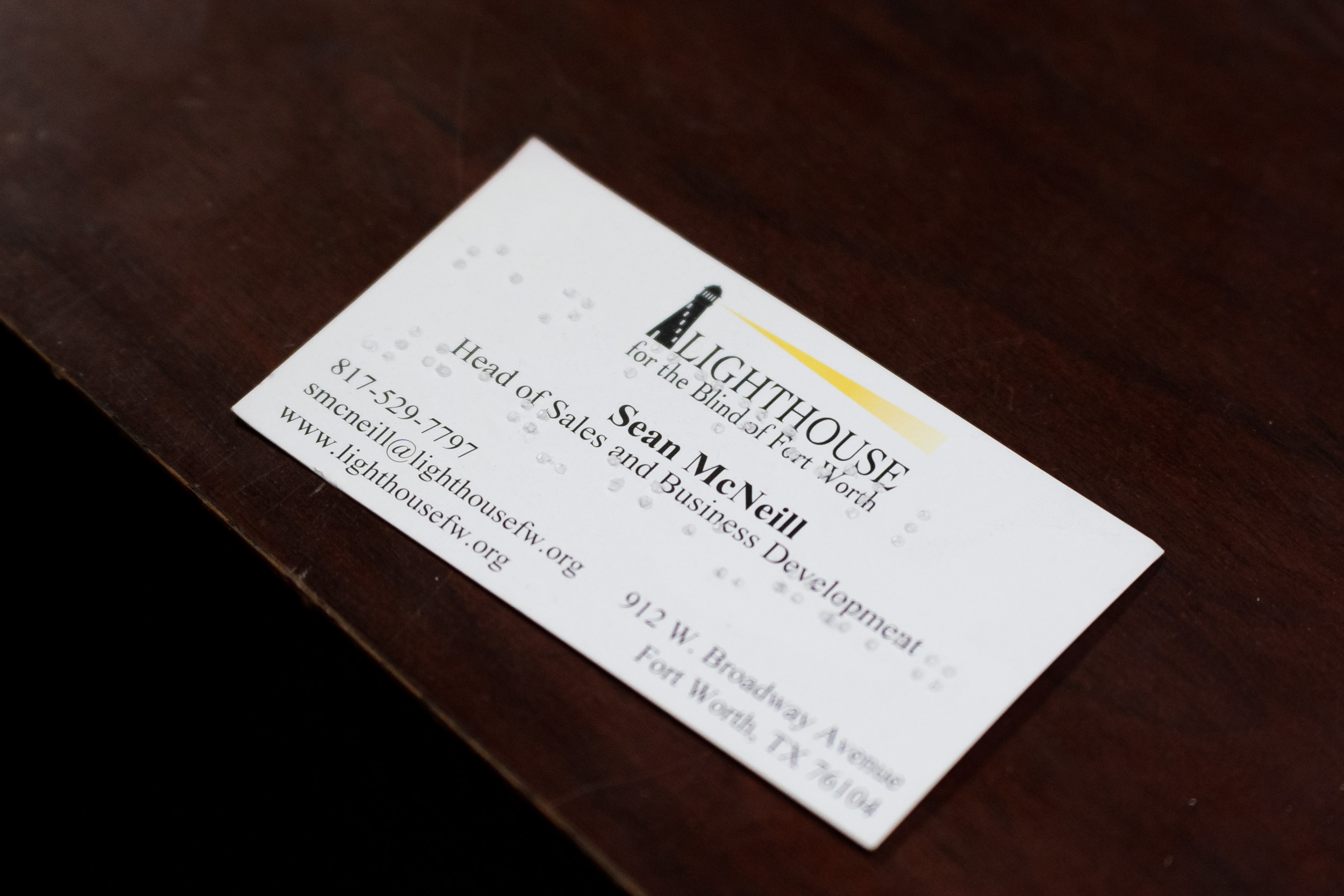 A business card with braille on it