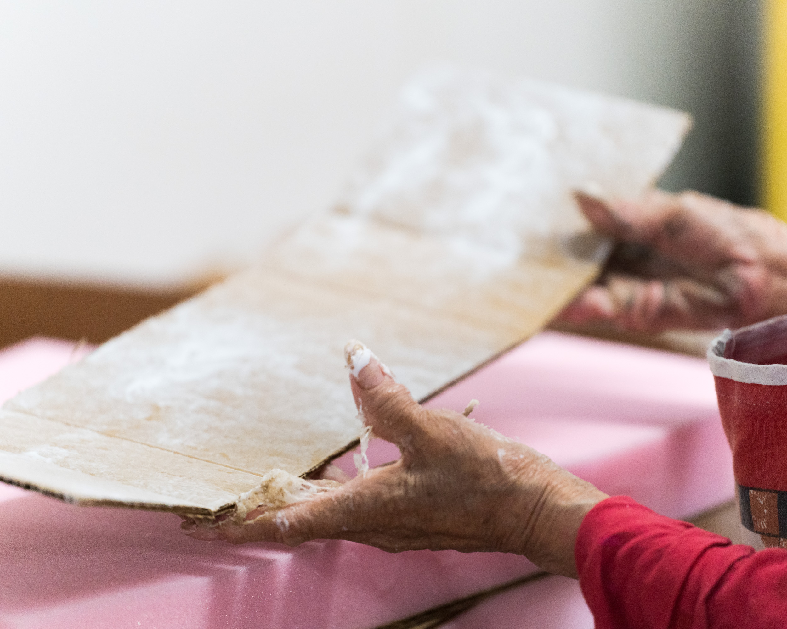 A woman's hands folding cardboard