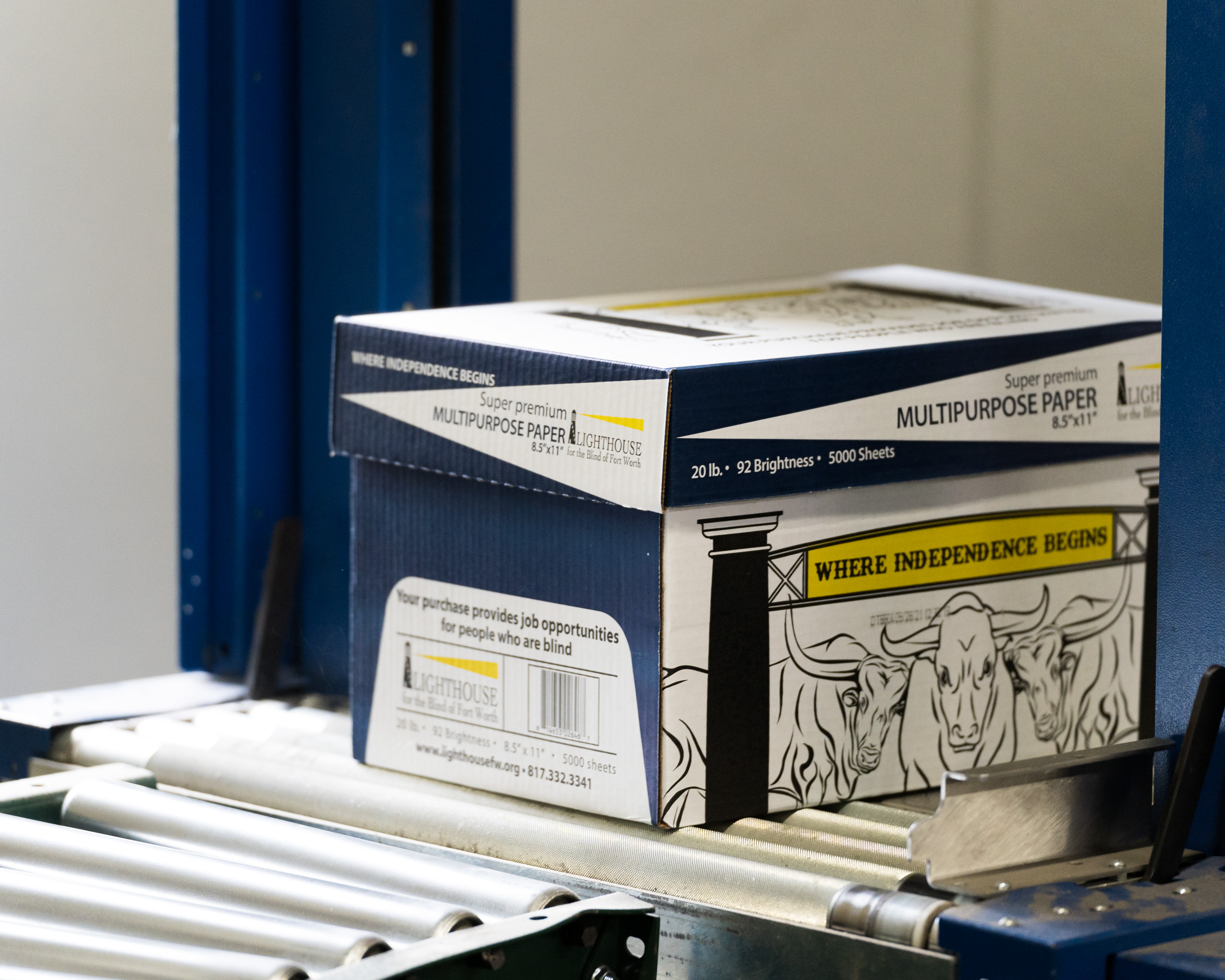 A box of paper on a rolling belt